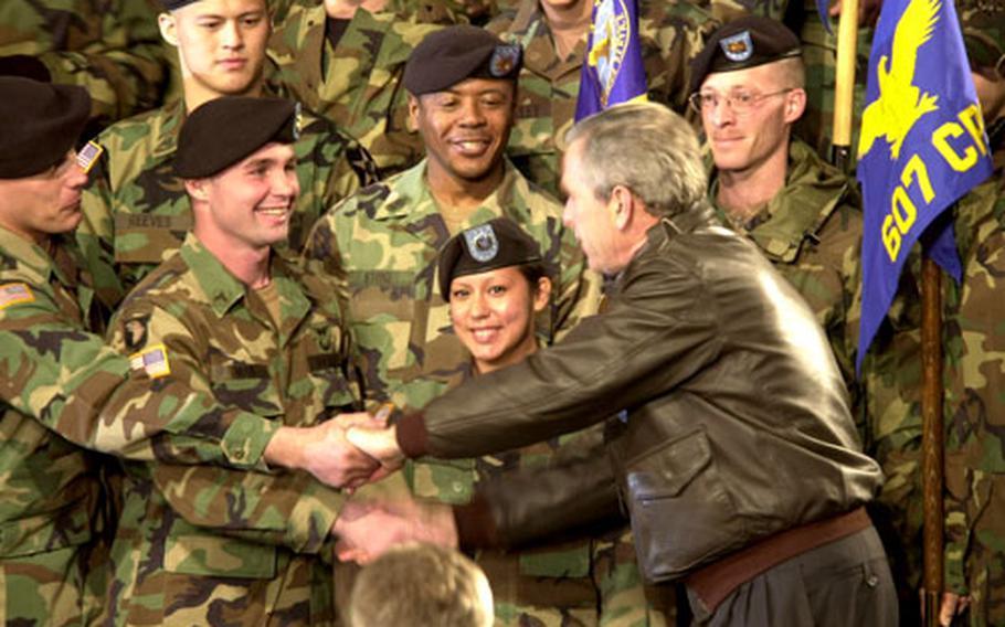 President Bush shakes hands with the troops Saturday at Osan Air Base.