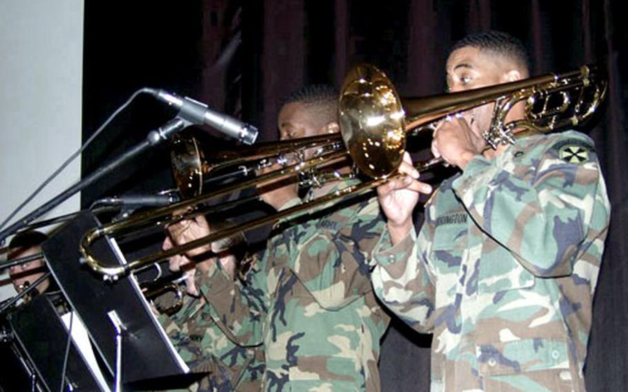 The horn section of the Eighth U.S. Army's salsa combo perform last month at U.S. Army Troop Command Korea's Hispanic Heritage celebration on Yongsan Garrison in Seoul.