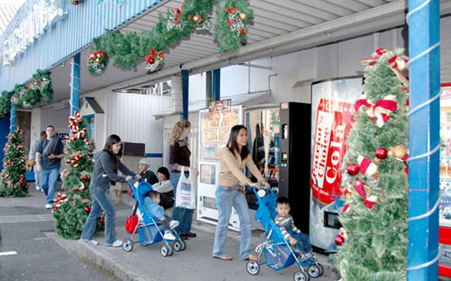 The Navy Exchange at Sasebo Naval Base, Japan, is already decked out with Christmas decorations, and soon much of the rest of the base will be decorated with bright lights, figurines, holly and candy-cane ribbon.