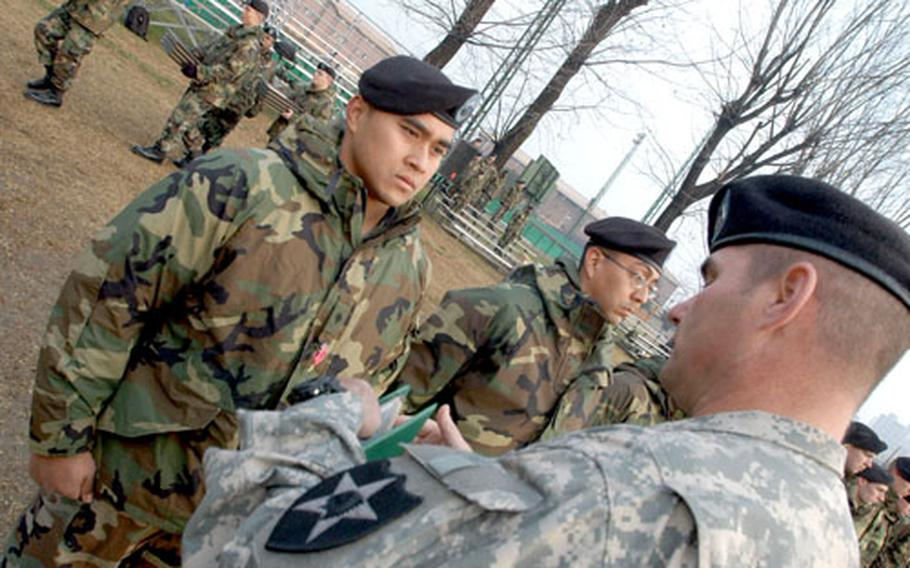 2nd Infantry Division Command Sgt. Maj. James A. Benedict pins the Bronze Star with Valor on Spc. Rodney Roby at Camp Red Cloud on Monday.