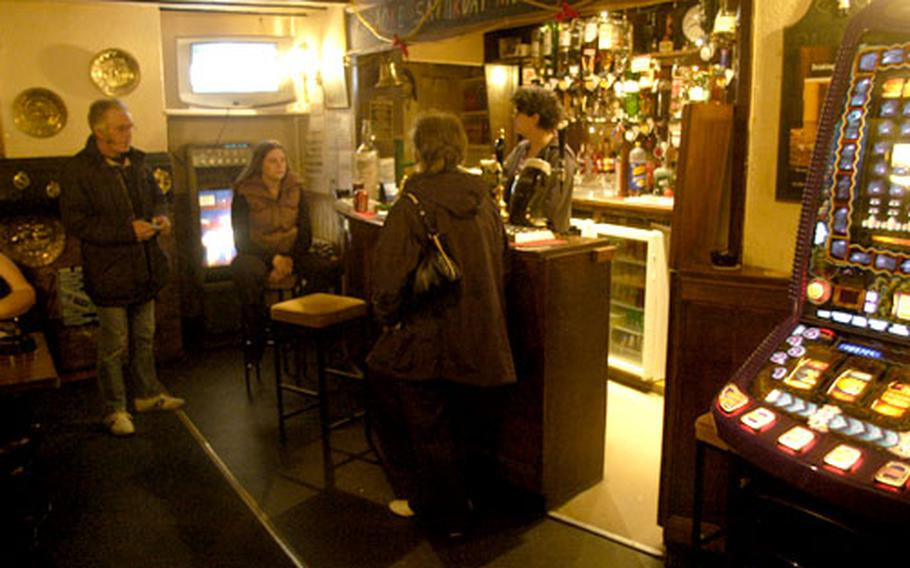 American Dana Lyga tends bar at the White Horse Pub.
