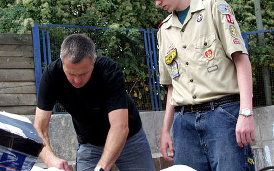 Boy Scout Dylan Baker, right, is briefed by Eduard Griesmann, technical supervisor at Hanau's Waste Management Office in Hanau, Germany. Earlier this year, the 15-year-old Baker delved into the world of recycling for his Eagle badge project.