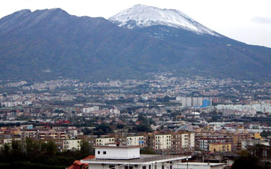 A snow-capped Mount Vesuvius greeted Neapolitans on Tuesday and Wednesday as temperatures dipped below freezing and a biting wind forced residents to bundle up. While the sight of snow on Mount Vesuvius isn't an aberration, it's a view not usually seen before late December or early January.