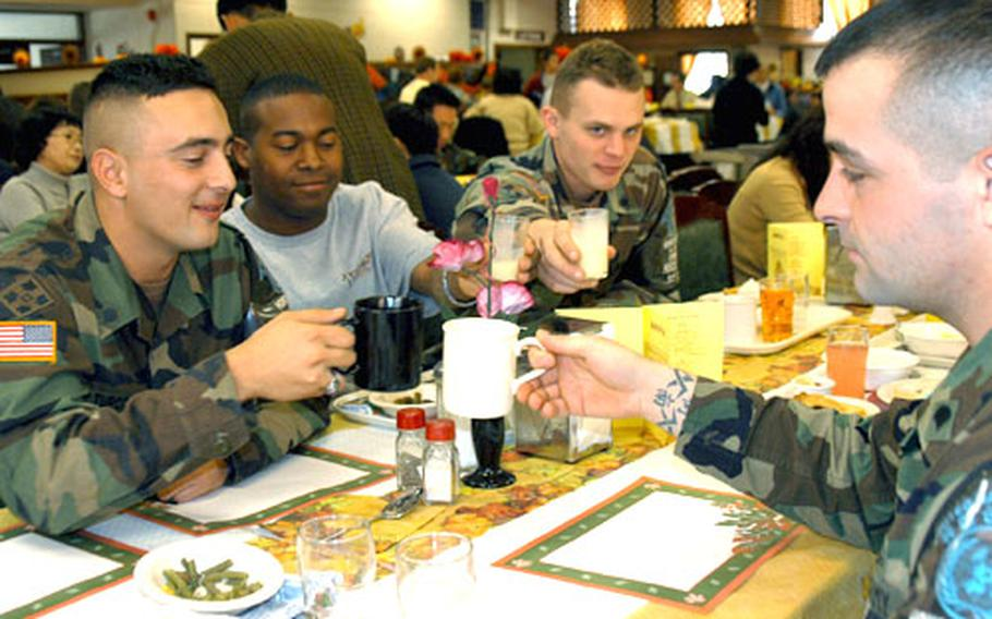 A Thanksgiving toast with coffee and egg nog at the Three Kingdoms Inn on Yongsan Garrison. From left, clockwise, are: Spc. Anthony Turco, 24, of Houston; Spc. Marcellus Fields, 26, of Portsmouth, Va.; Spc. Jon MacAbam, 21, of Harrisburg, Pa.; and Spc. James Baum, 26, of Staten Island. All are members of the United Nations Command Honor Guard, and all worked during the holiday.