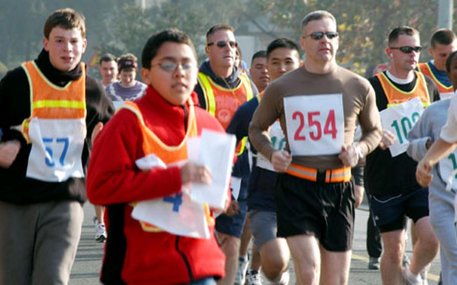 More than 80 people joined in the Turkey Trot run. Defending champion Brig. Gen. Steve Anderson, USFK's chief of logistics, finished first in 17 minutes and 22 seconds, and won a turkey dinner for 10.