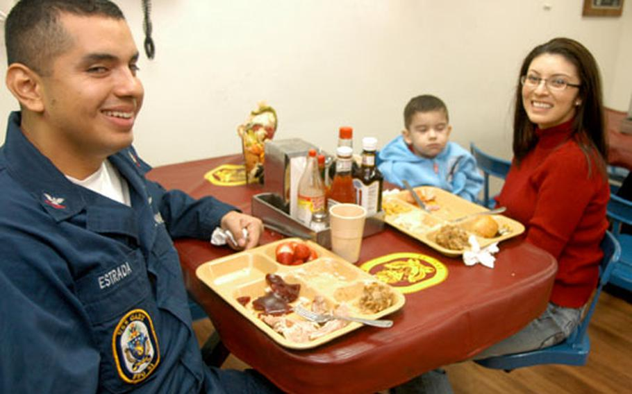 Duty didn't dent Thanksgiving, said Petty Officer 2nd Class Cesar Estrada, who brought his wife Irma and child Cesar Estrada Jr. to the USS Gary for dinner.