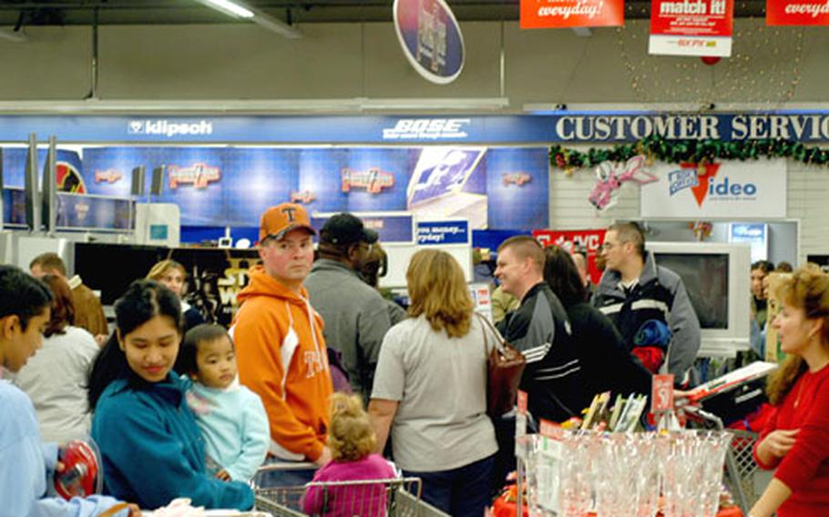 The Power Zone area of the base exchange at Aviano Air Base, Italy, was a popular place Friday morning, with hundreds of shoppers entering the area before it normally would have been open to the public to look for bargains. Business was brisk at AAFES stores around Europe, an AAFES spokeswoman said.