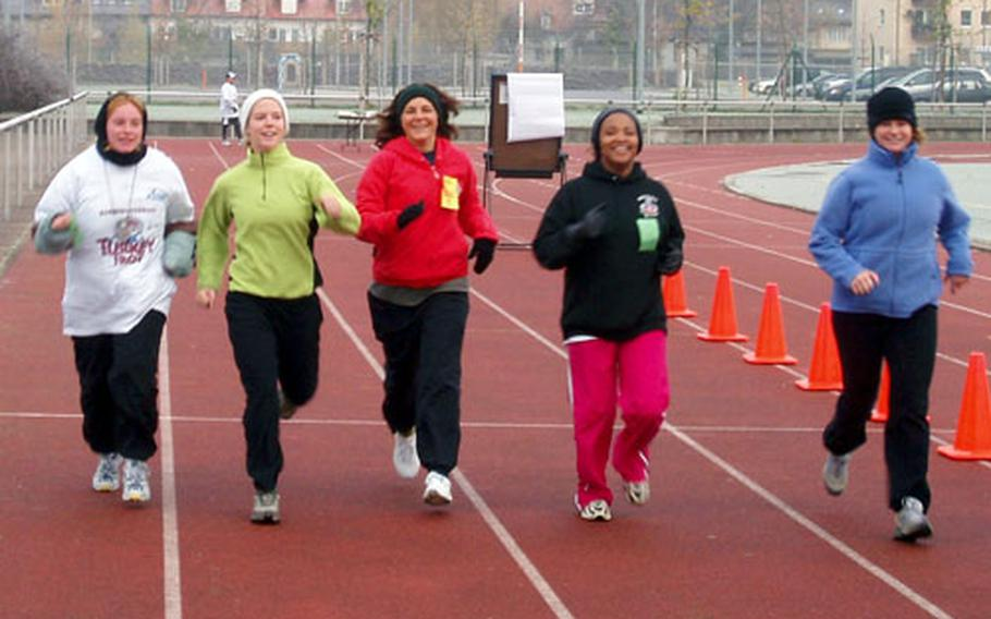 Brenda Swartz, center, and other family members from the 54th Engineer Battalion family fitness program run during the Warner Barracks Turkey Trot on Nov. 18. Swartz is the battalion's family readiness support assistant.