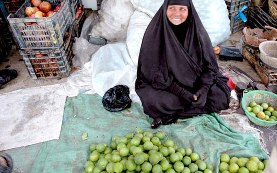 """Life """"is better now,"""" says Latifa Hussein, 50, an orange seller at a local market, who said she's seen positive change since Saddam was removed from office."""