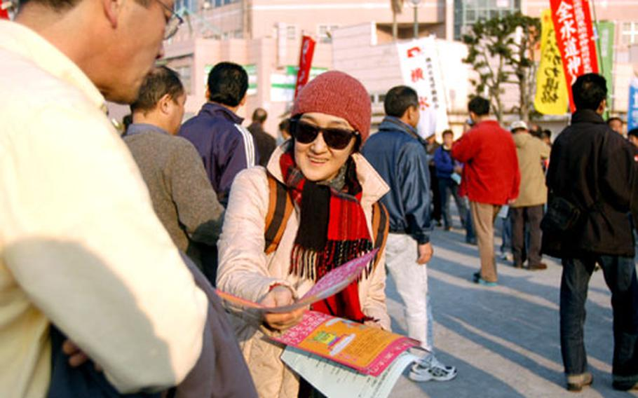 An activist passes out flyers promoting peace during Sunday's demonstration.