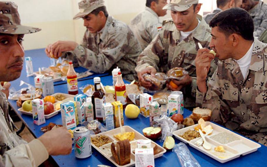 Iraqi soldiers, who lived at FOB McHenry for a week during their training, have breakfast at the chow hall.