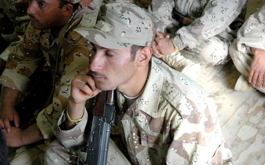 Iraqi soldiers attend a training session on basic rifle marksmanship.