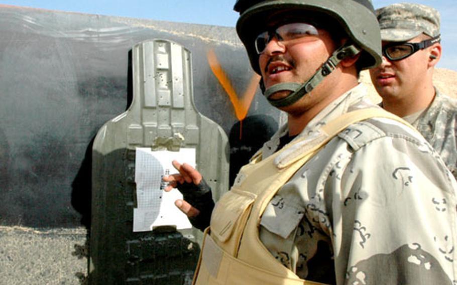 Sgt. Ismael Shlash Habib admires his marksmanship during a rifle training exercise.