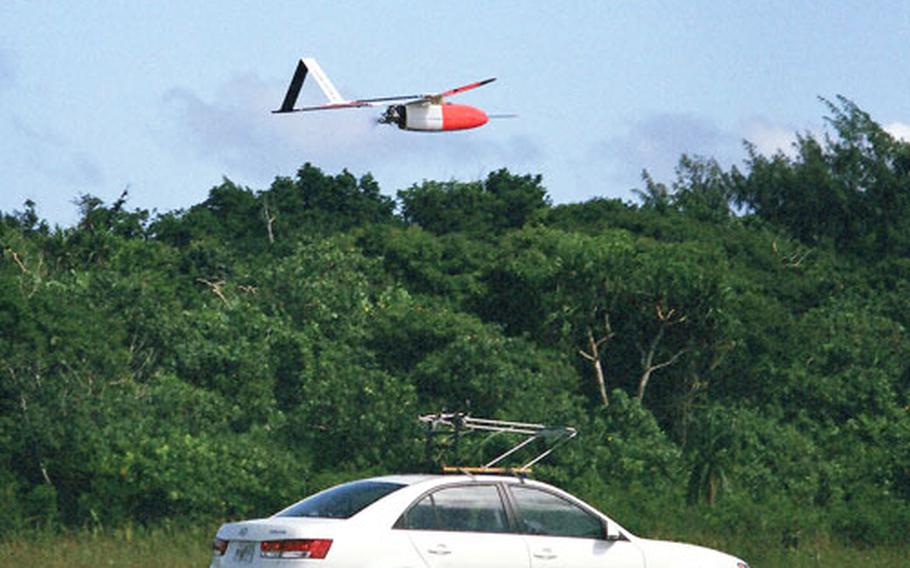 The Weatherscout unmanned aerial vehicle lifts off its launch vehicle for a test flight Oct. 18.