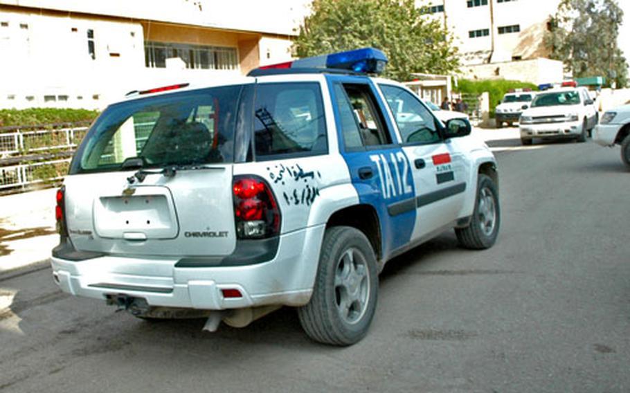 A law enforcement vehicle sits outside Kirkuk's main police station.