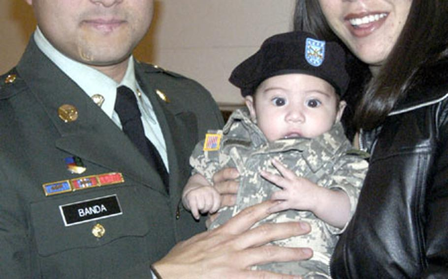 Hector Banda, originally from Mexico, with wife Melissa and two-month-old son Ethan following the military naturalization ceremony in Heidelberg, Germany, where Banda became an American citizen.