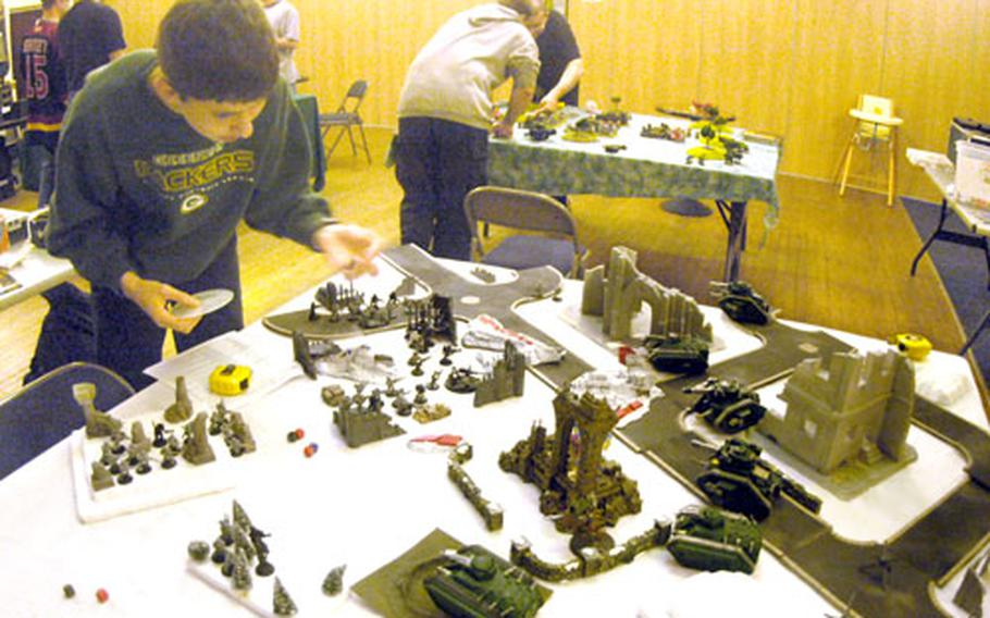 Christopher Damers places his army on one of the tables in the Bob Hope Community Center ballroom.