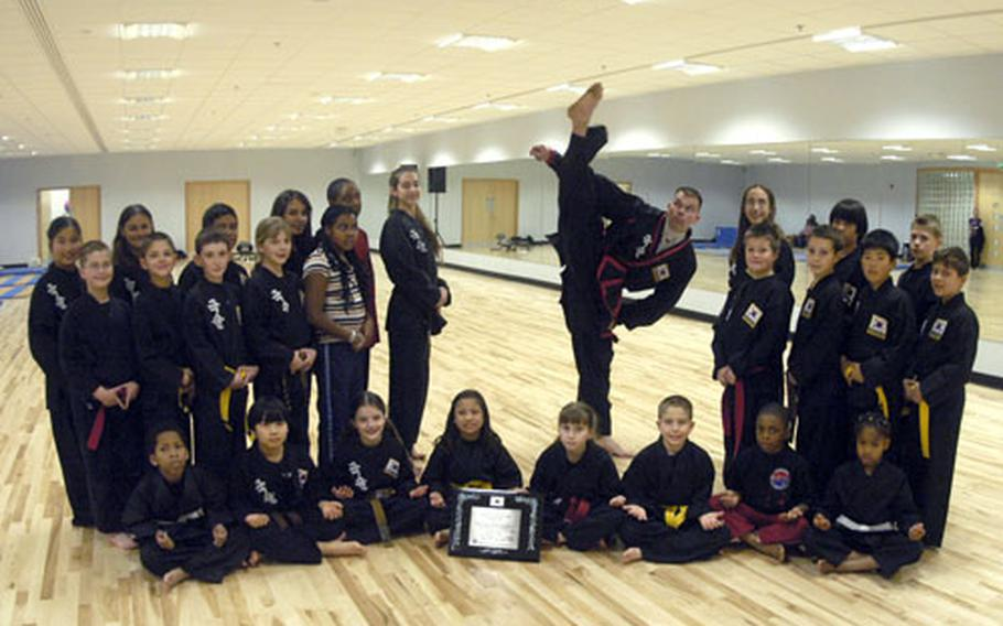 Darren Hart poses with his students during his RAF Lakenheath Kuk Sool Won class.