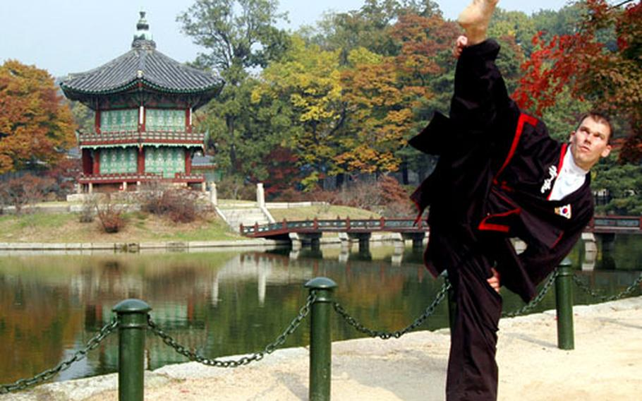 Darren Hart kicks outside of a Korean temple in October. Hart was in Korea to receive his Kuk Sool Won black belt master certification.