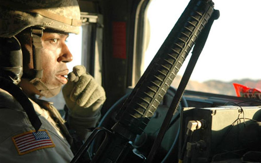 Sgt. Lehmann Skinner, 38, prepares to roll out on a convoy support mission in western Iraq. Skinner is a member of the 46th Engineer Battalion's convoy escort, or Tactical Movement Team.