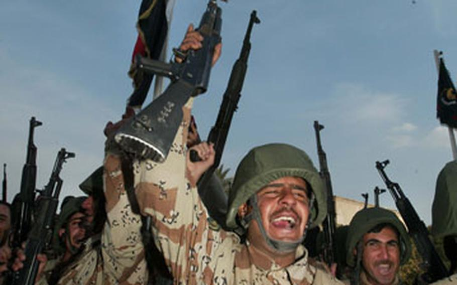 Iraqi soldiers of the 5th Brigade celebrate during a transition-of-authority ceremony of Forward Operating Base Camp Honor on Tuesday in Baghdad.