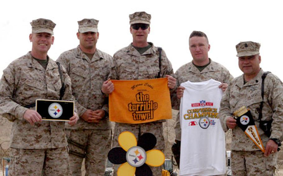 From left, Lt. Col. Timothy B. Seamon, Capt. Trent Morrow, Gunnery Sgt. Stephen B. Johnson, Chief Petty Officer Mark F. Bryan, and Capt. Charles T. Atwood pose with Steelers memorabilia at Camp Taqqadum. All are assigned to the 2nd Marine Logistics Group (Forward).