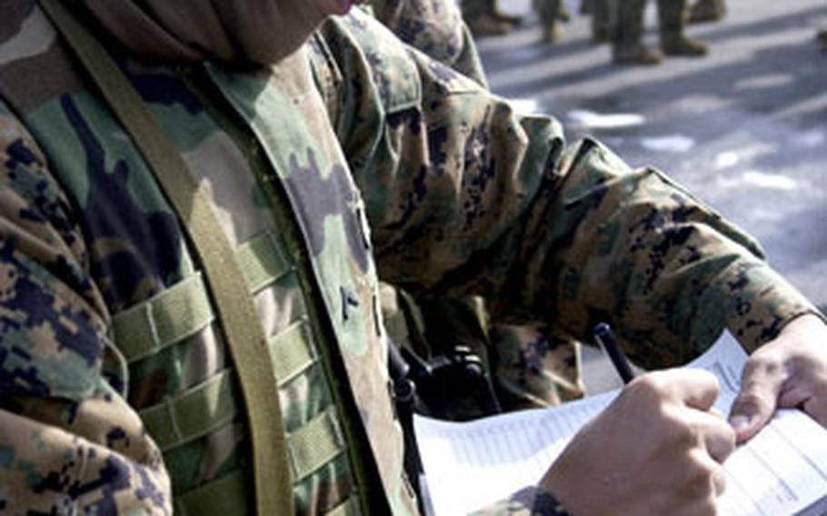 Marine Pfc. Ralph Perez fills out the manifest for the vehicle he will be riding on during convoy operations training Jan. 25 at Camp Fuji.