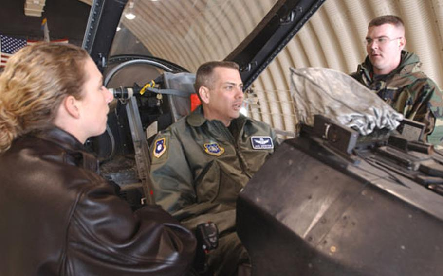 At Kunsan Air Base in South Korea earlier this week, Air Force Col. Jack Weinstein, a member of the Installation Excellence selection board, sits in the cockpit of an F-16 fighter jet of Kunsan's 8th Fighter Wing and talks with wing members. The board is evaluating Kunsan and two other Air Force installations in the running for a top-level Defense Department award for excellence.