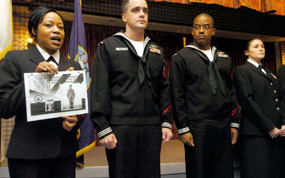 Petty Officer 1st Class Latricia Robinson speaks of Petty Officer 1st Class Charity Broomfield, who is deployed and was unable to accept her Sailor of the Year award in person during a ceremony at the Chief Petty Officers Club at Yokosuka Naval Base, Japan, on Thursday.