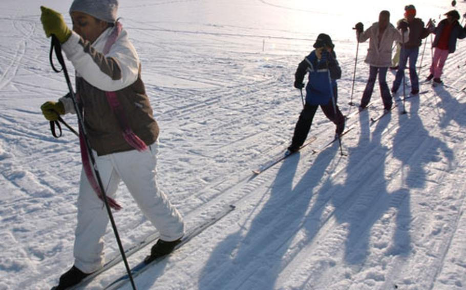 Tunisia Jenkins, a fifth-grader at Cummings Elementary School on Misawa Air Base, Japan, leads a group of Nordic skiers Tuesday on Gosser Memorial Golf Course. Every day after school, a small group of students skis on the course. Two fresh sets of ski tracks are groomed daily around the course perimeter.