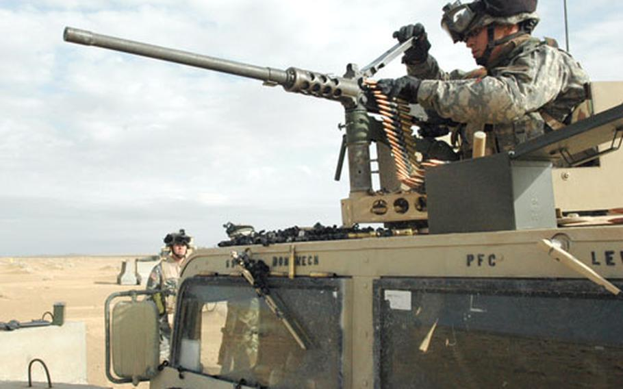 Pfc. Mitchell Brandt prepares to fire a 50-caliber machine gun at a range outside Camp Buehring in Kuwait.