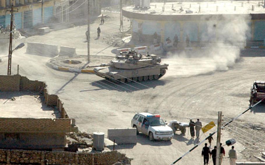 U.S. tanks patrol downtown Tal Afar.