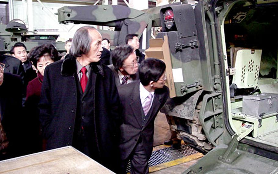 Local clergy peer into an armored vehicle at the Army's Materiel Support Center-Korea during a recent tour of Camp Carroll. It was the first time post officials had hosted such a tour for local clergy.