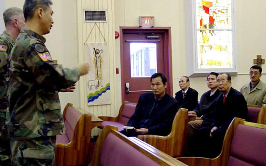 Two U.S. Army chaplains talk with local South Korean clergy members inside one of Camp Carroll's chapels.