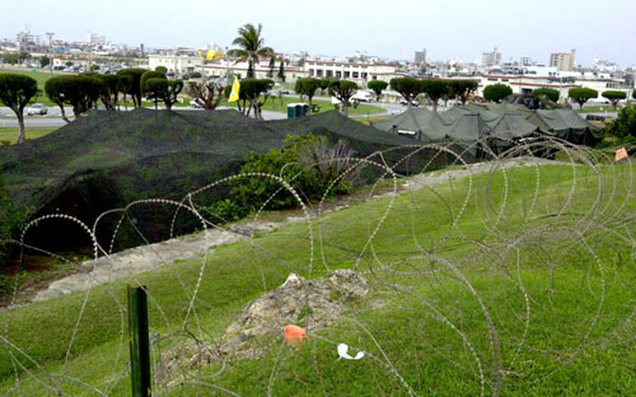 Marines from Marine Wing Communication Squadron 18 set up a communications site, complete with camouflage netting and concertina wire, on Camp Foster, Okinawa, from Jan. 13 to Feb. 2. The unit set up to practice for upcoming exercises in South Korea.