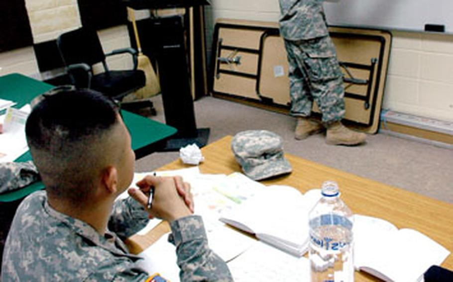 Spc. Nathan Picchocki, right, leads a Arabic language class for a small group of soldiers from the 1st Armored Division's 2nd Brigade at Camp Buehring, Kuwait.