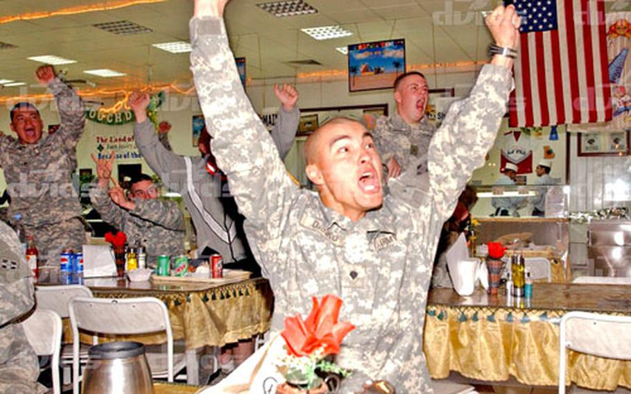 As the clock strikes 4 a.m. in Iraq, Spc. John Danko cheers on the Pittsburgh Steelers during their 21-10 victory in Super Bowl XL in Detroit. Danko, a native of Uniontown, Pa., is a member of the 4th Infantry Division's Headquarters and Headquarters Company, Special Troops Battalion.