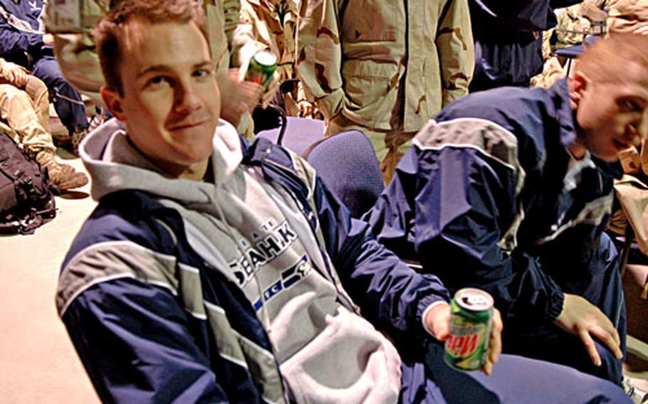 Senior Airman Bryan Martin, of Tacoma, Wash., watched the Super Bowl from Manas Air Base early Monday morning.