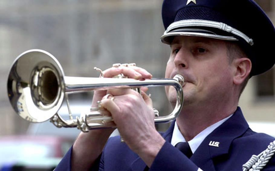 """Staff Sgt. James Hooter performs """"Taps"""" at a memorial service on Monday for Lindsey Ferris."""