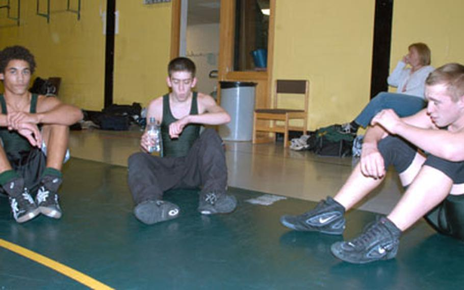 Alconbury High School wrestlers Kyle Lucas, left, Joshua Williamson and Douglas Bagnall take a breather at a recent practice.