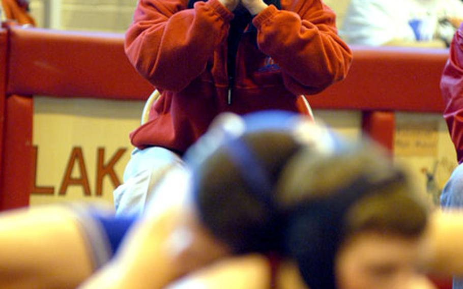 Menwith Hill assistant coach Bryce Gosney yells some pointers to Chris Brew, bottom, during a bout against London Central's Mike Flores.