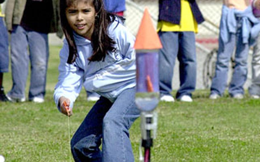 Vanessa Cordova prepares to pull the string to launch her water bottle rocket Tuesday.
