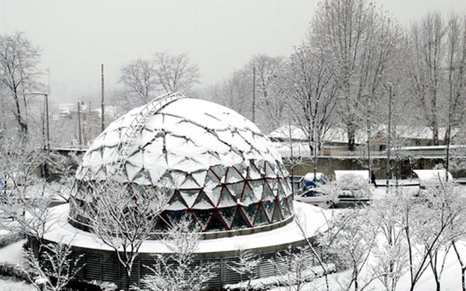 Thick, wet snow nearly covered the domed subway station at Noksapyeong near Yongsan Garrison, South Korea, on Tuesday.