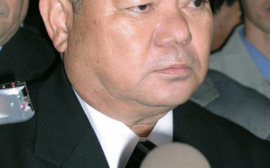 Nago Mayor Yoshikazu Shimabukuro speaks to reporters following his swearing-in on Wednesday.