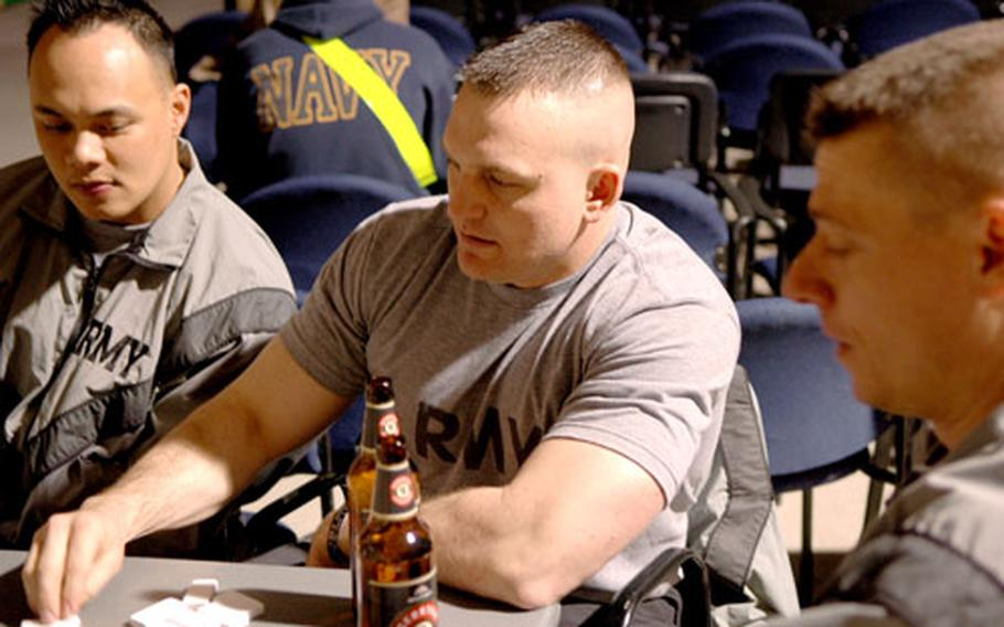 First Lt. Travis Gilbert, 34, center, enjoys his first beer since returning from a yearlong deployment in Afghanistan.