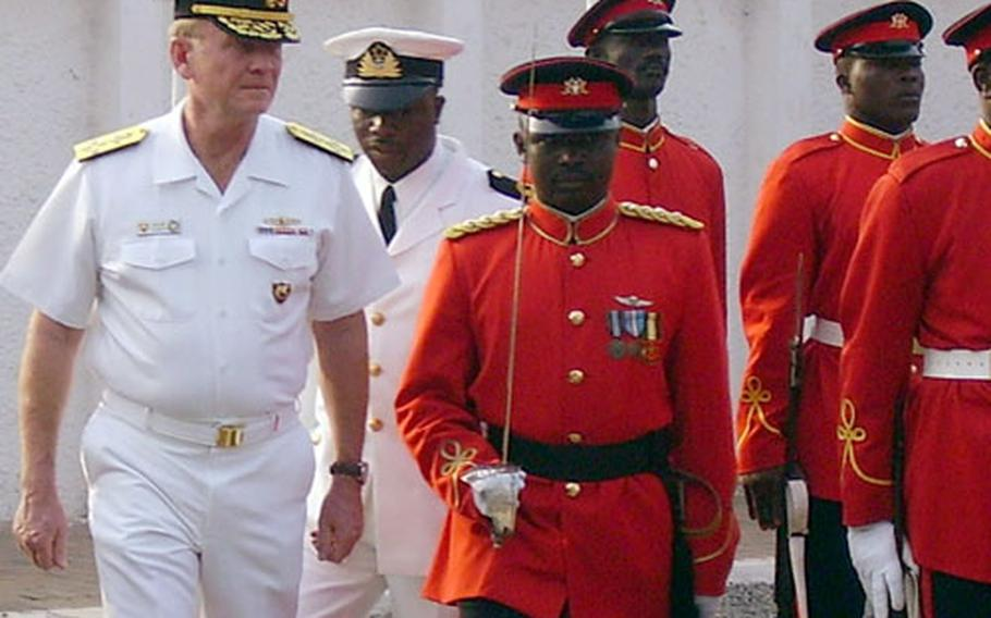 Adm. Harry Ulrich, commander, Naval Forces Europe, conducts a pass and review of Ghanaian military forces during his recent visit to Ghana. Ulrich recently met with the president of Ghana and other military and civilian leaders to discuss regional security issues in the Gulf of Guinea.