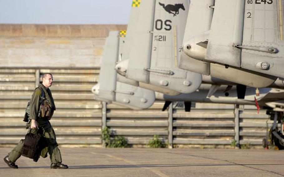 Maj. Chris Price steps to his A-10 before a Cope Tiger '06 mission at Korat Royal Air Force Base, Thailand, on Wednesday. Price, with the 25th Fighter Squadron from Osan Air Base, South Korea is one of about 300 U.S. servicemembers taking in a multi-lateral exercise at this air base about 110 miles northeast of Bangkok.