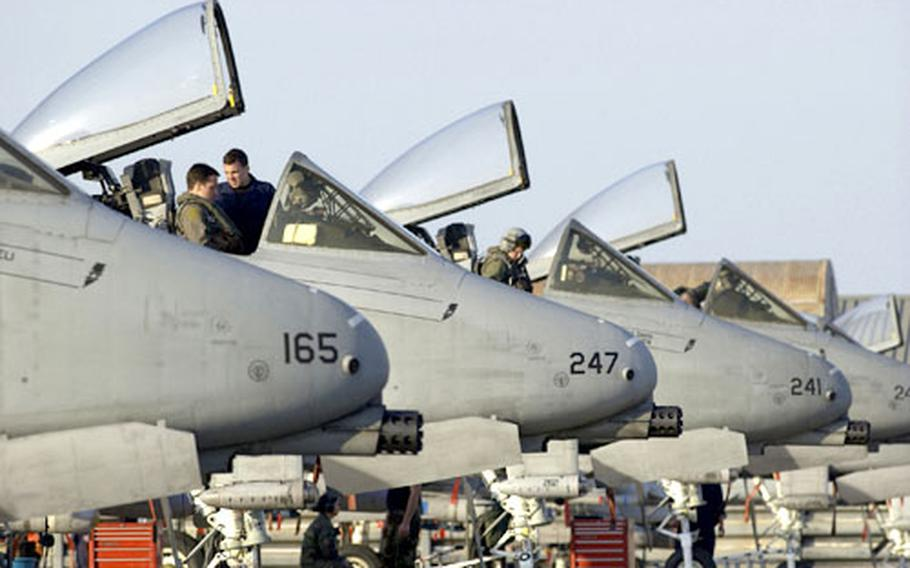 Aircrews from the 25th Fighter Squadron from Osan Air Base, South Korea, perform pre-flight procedures on a flightline ramp at Korat Royal Air Force Base on Wednesday.