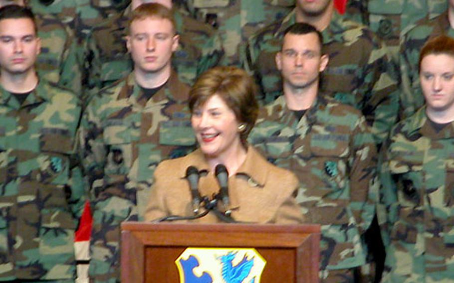 First lady Laura Bush stopped by Aviano Air Base, Italy, on Friday morning before leading the presidential Olympic delegation on to Friday night's opening ceremonies in Turin.