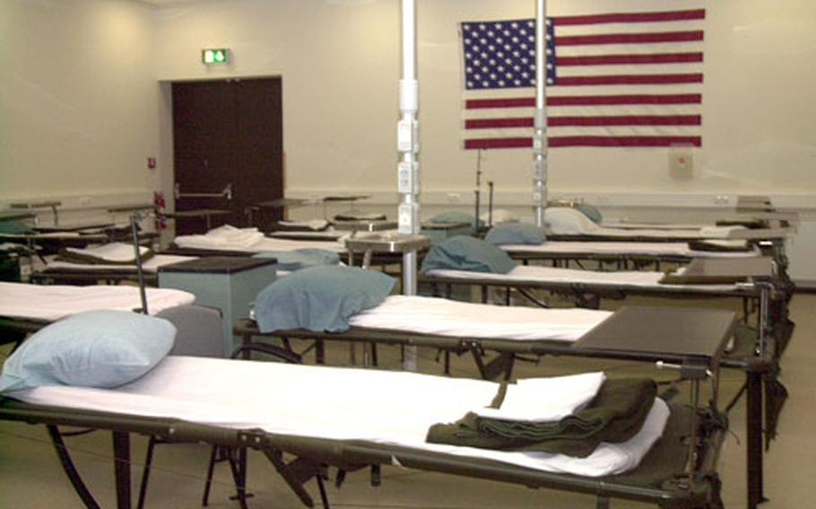 Neatly-made beds, or litters, for wounded patients at the new Contingency Aeromedical Staging Facility at Ramstein Air Base, Germany. The Air Force officially opened the building on Friday.